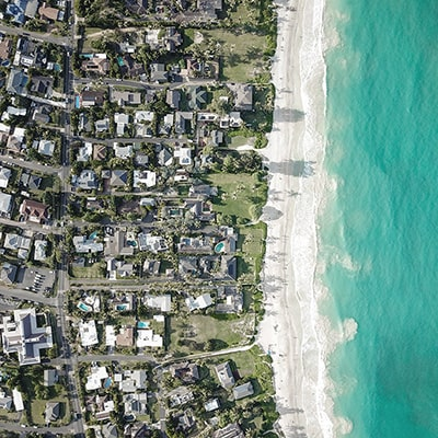 Top aerial view of homes in a private beach.